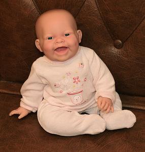 Кукла Реборн — улыбающийся малыш